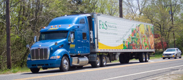 Truck on the road & Mid Eastern Cold Storage | Transportation